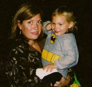 Eli with mom in batman jamies