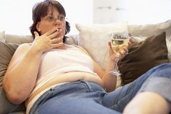 Woman drinking wine and smoking