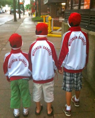 3 boys in Badger warm ups